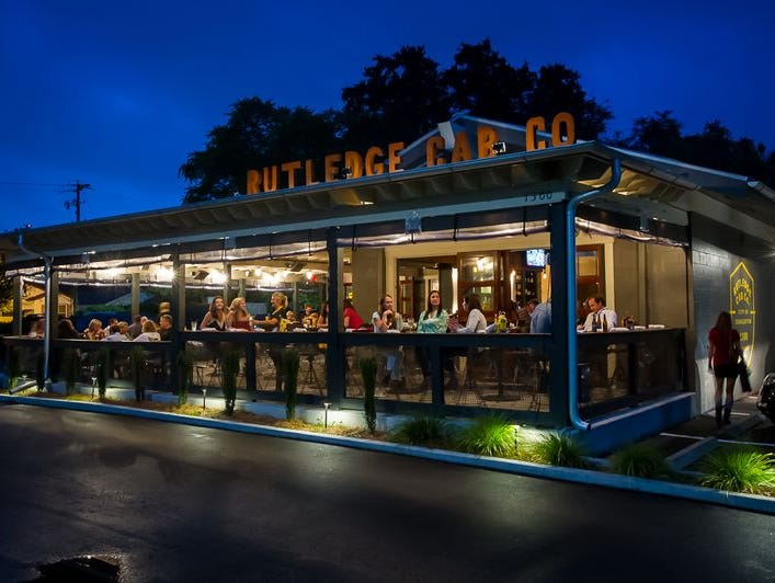 Exposed brick and salvaged barn wood lend Rutledge Cab Company in uptown's Wagener Terrace neighborhood a retro diner vibe.
