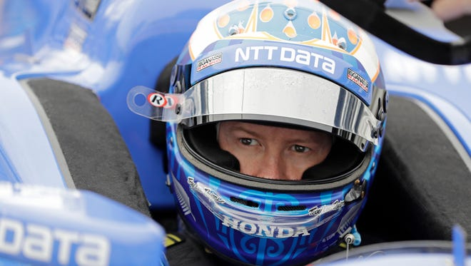 Indy 500 pole winner Scott Dixon was robbed at a Taco Bell drive-thru late Sunday night.