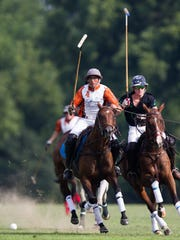 Lucas Tarditto, left, of Argentina, and Ford Middendorf compete at the Virgil Christian Tribute Polo Match, a fundraiser for Maryhurst, an organization that fights the cycle of abuse. July 22, 2017.