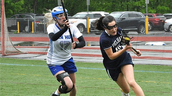 Hen Hud's Rachel Palka (l) chases Pelham's Maria Comeford (r). Photo from May 19, 2018.