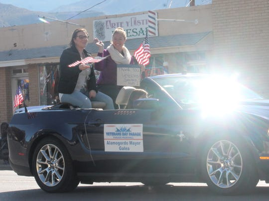 Mayor Susie Galea waves to residents during this year's Veteran's Day Parade.