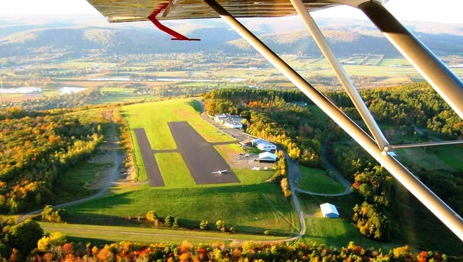 Soaring at Harris Hill near Elmira gives a bird's-eye view of the fall colors blanketing the hills below.