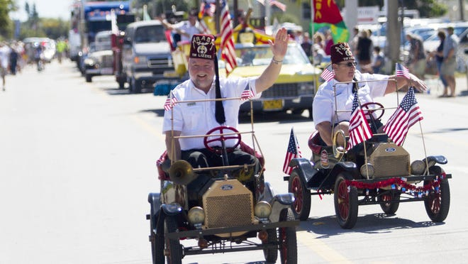 Members of the Tin Lizzies of the Araba Shrine Temple take part in the 2014 Shrimp Festival Parade on Fort Myers Beach on Saturday.