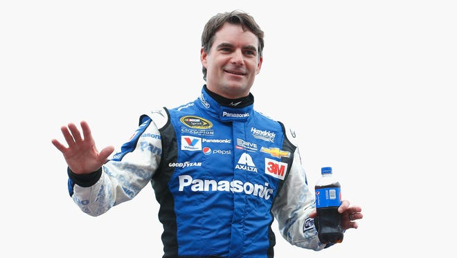 Jeff Gordon, driver of the #24 Panasonic Chevrolet, takes part in pre-race ceremonies for the NASCAR Sprint Cup Series Duck Commander 500 at Texas Motor Speedway on April 11, 2015 in Fort Worth, Texas.