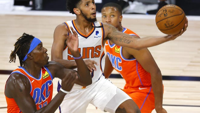 Cameron Payne of the Phoenix Suns goes up for a shot in the fourth quarter.