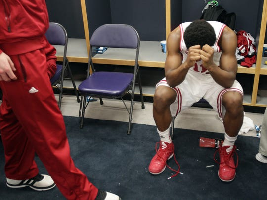 Yogi Ferrell of Indiana, sits in the locker room following their loss to Syracuse, Verizon Center, Washington, D.C., March 28, 2013. Syracuse won 61-50.