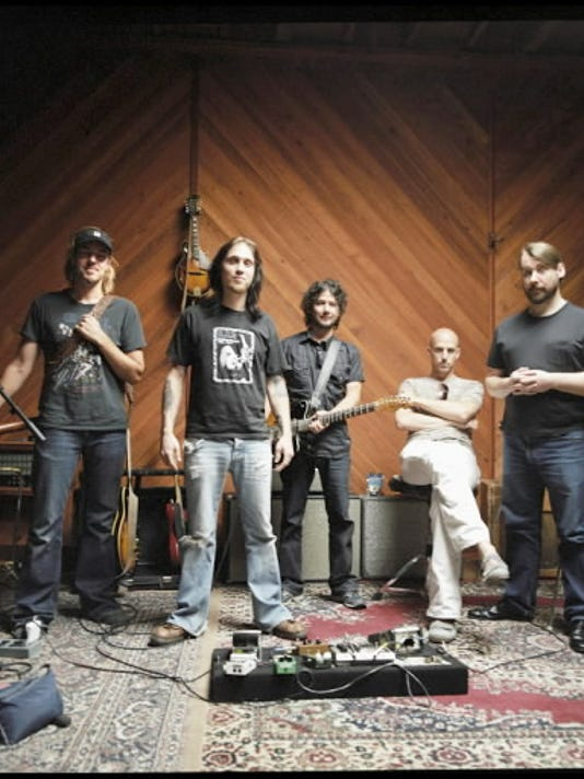 Chris Thorn, center, is a Dover native and plays guitar for Blind Melon.