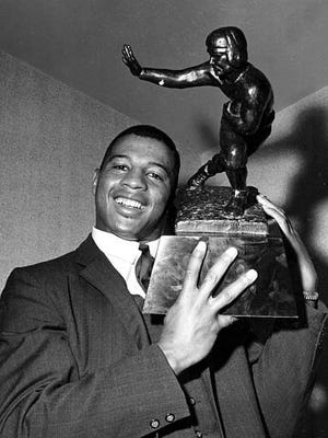 In 1961, Ernie Davis became the first African-American college football player to win the Heisman Trophy.