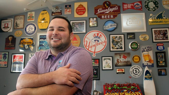Dan Pizzarelli, owner of DC Sports is photographed inside his Route 9 business in Wappingers Falls Dec. 30, 2016.