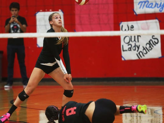 Indians Ashtyn Lyneis goes the ball after Asia O'neil (8) made a diving save as Palm Desert fell to Palm Springs in prep volleyball Tuesday, September 23, 2014 .