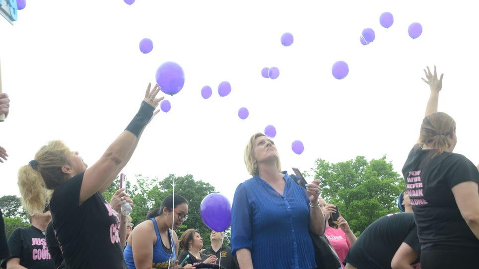 ANI Vicitims Rights Parade Stephanie Belgard (left) and Leah Baden release balloons in memory of their loved ones at Victims Rights Parade held Saturday, April 18, 2015. Belgard's daughter Courtney Coco was a 19-year-old whose remains were found in Texas 1