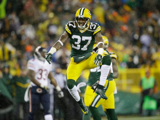 FILE - In this Nov. 26, 2015, file photo, Green Bay Packers' Sam Shields celebrates his teammate Quinten Rollins' sack of Chicago Bears quarterback Jay Cutler during the second half of an NFL football game, in Green Bay, Wis. Well here's a change for the Green Bay Packers: their defense has been much more consistent this year than the offense, capable even of carrying the team for stretches. (AP Photo/Jeffrey Phelps, File)