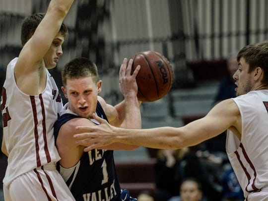 Lebanon Valley College's Sam Light drives to the hoop against Swathmore's Shane Loeffler (left) and Sean Thaxter (right) as Lebanon Valley College fell to Swathmore 81-60 in the first round of the NCAA Division III ECAC tournament on Wednesday, March 2, 2016.