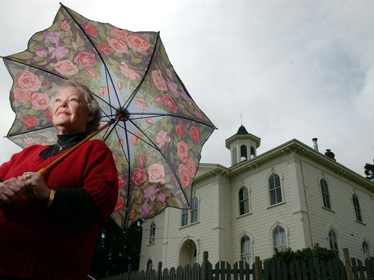 """Donna Freeman is photographed outside the Potter School in Bodega Bay, Calif., Tuesday, April 29, 2003. Freeman was an extra during the filming of Alfred Hitchcock's """"The Birds,"""" which was filmed in Bodega Bay in 1962. The Potter school is in one of the film's key scenes."""