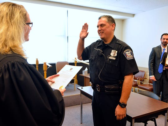 Newly sworn-in West York Mayor Shawn Mauck, right,
