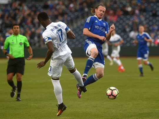 Reno 1868 FC's Mackenzie Pridham (8) battles Colorado Springs' Sean McFarlane (17) for the ball during their soccer game at Greater Nevada Field in Reno on April 22, 2017.