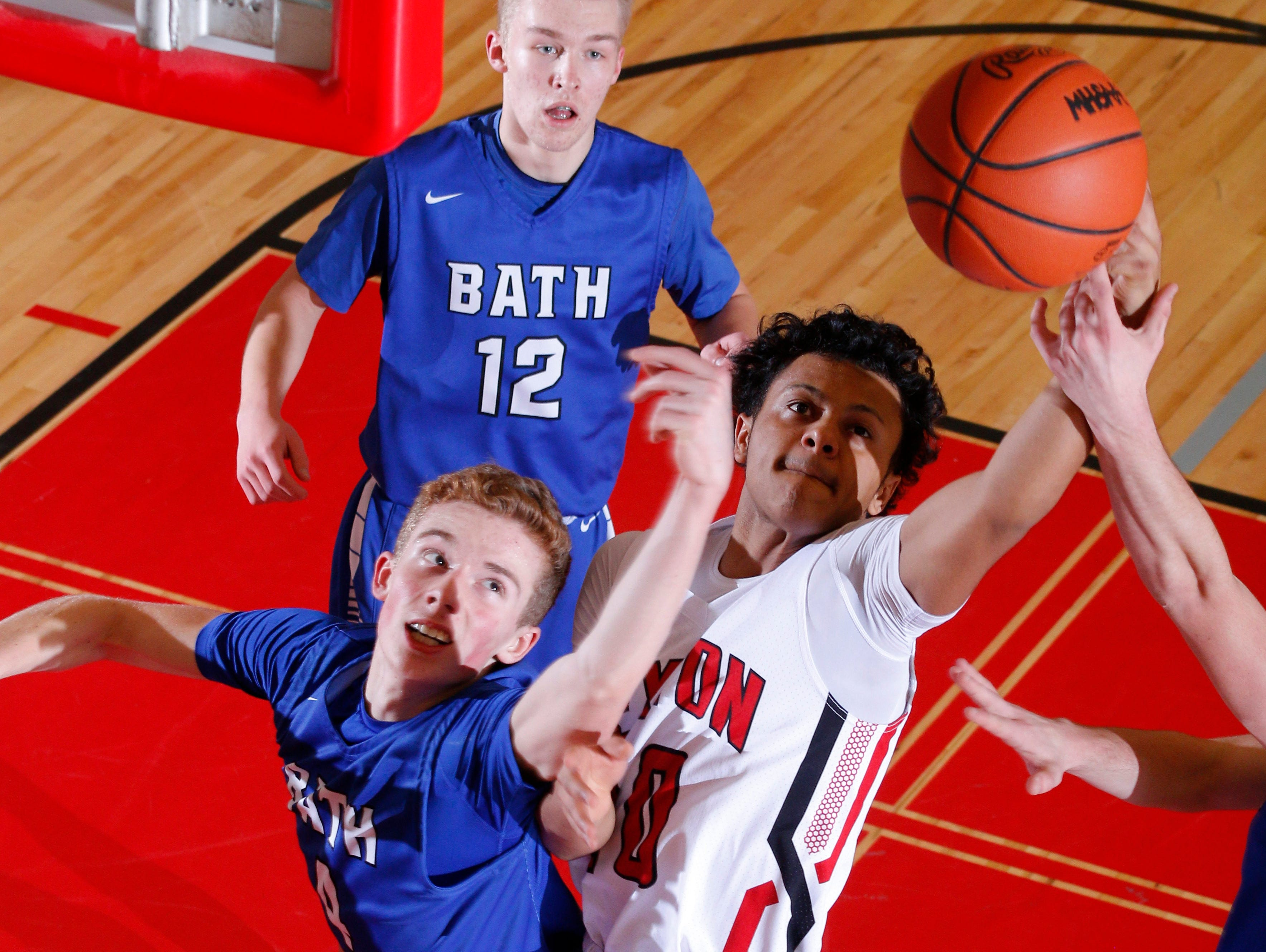 Sexton's Brandon Powers, right, and Bath's Jakob Cain reach for a rebound Tuesday, Feb. 7, 2017, in Lansing, Mich. Sexton won 82-39.