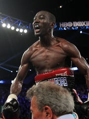 June 28, 2014, Omaha,Nebraska ---- WBO Lightweight champion Terence Crawford of Omaha knocks out and Olympic gold medalist Yuriorkis Gamboa in the 9th round, at the Centurylink Center in Omaha.