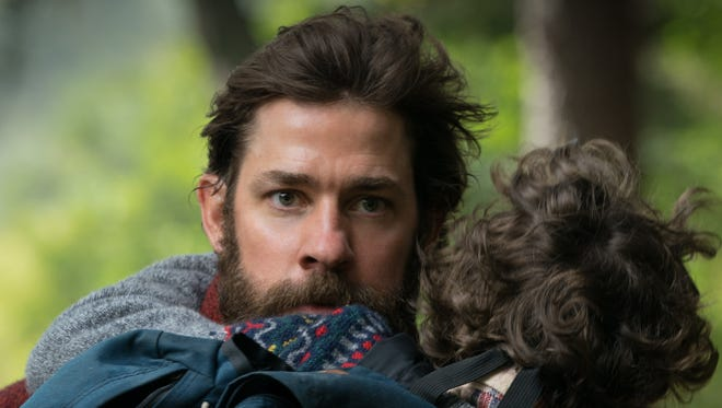 "Lee (John Krasinski) holds his son (Noah Jupe) in ""A Quiet Place."""