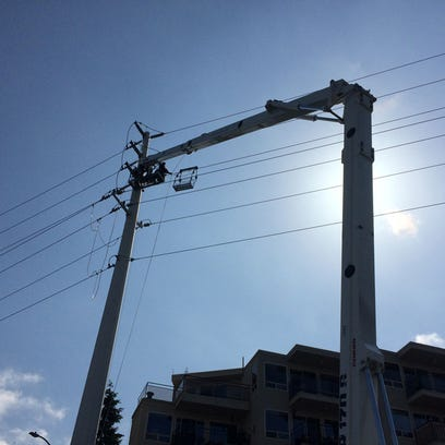 Seattle City Light crews remove a drone stuck in power