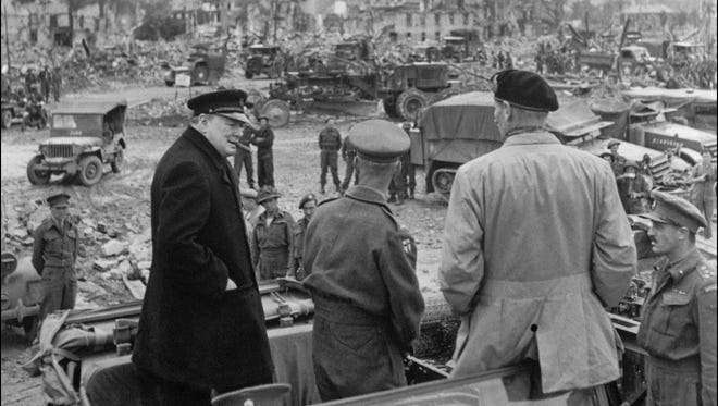 British Prime Minister Winston Churchill visits the destroyed city of Caen, after Allied forces stormed the Normandy beaches on D-Day.
