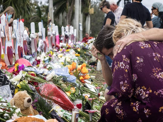 epaselect epa06547203 People visit a makeshift memorial in front of the Marjory Stoneman Douglas High School in, Parkland, Florida, USA, 20 February 2018. Residents in the community honor victims of a mass shooting that took place at Marjory Stoneman Douglas High School on 14 February that left 17 dead. Nikolas Jacob Cruz, reportedly an expelled student, has been charged with seventeen counts of premeditated murder in the shooting at Marjory Stoneman Douglas High School in Parkland, Florida on 14 February 2018. EPA-EFE/CRISTOBAL HERRERA