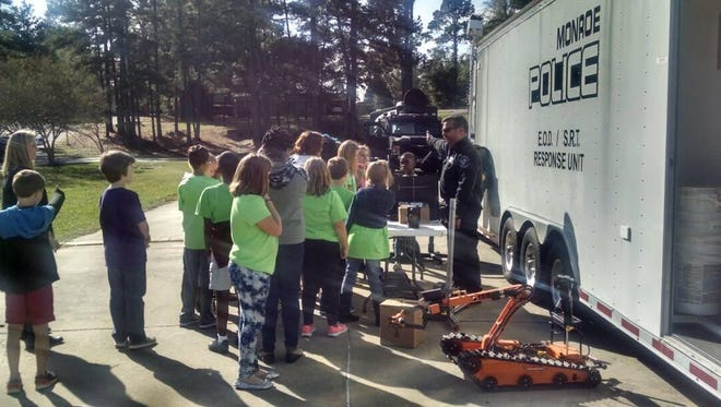 Monroe Police officers hosted a public safety expo at Kiroli Elementary Tuesday