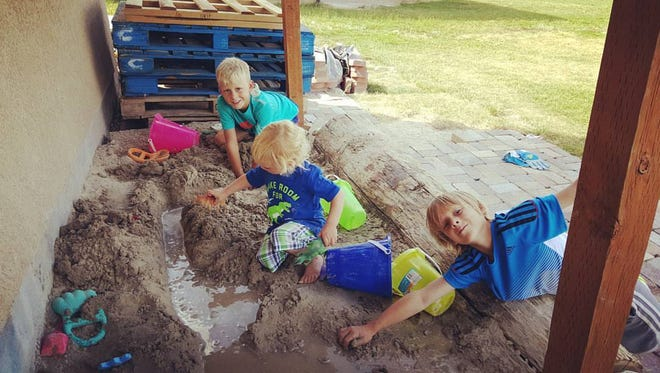 Arianne Brown's sons enjoying the sand for the summer.