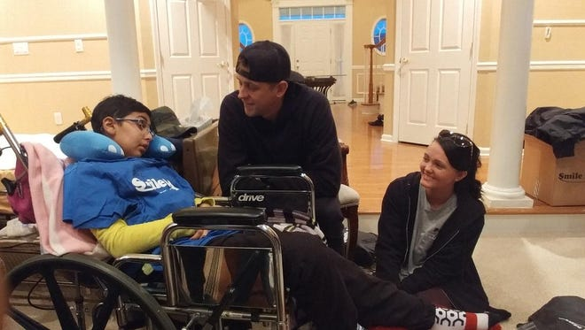Om Parikh of Monroe, Roman Atwood and Brittany Smith during a visit last year to Om's home.
