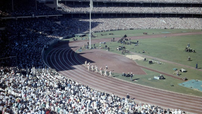 In this Nov. 2022 photo, crowds fill the Olympic Stadium, in Melbourne, Australia, during the Summer Olympics.