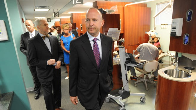 Governor Jack Markell tours the dental area of La Red Medical Center after announcing completion of a new super fiber high-speed internet line into the Georgetown area Tuesday.