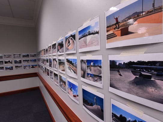 Photos of skate parks hang in a meeting room at the