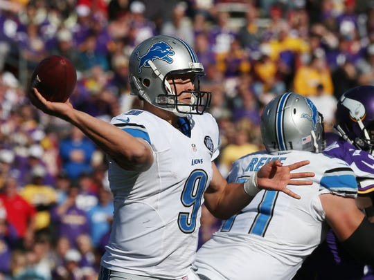 Detroit Lions quarterback Matthew Stafford (9) throws during the second half of an NFL football game against the Minnesota Vikings, Sunday, Oct. 12, 2014, in Minneapolis.
