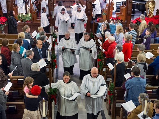 The York Ecumenical Choral Society walks though the congregation concluding the York Ecumenical Choral Society's Festival of Nine Lessons and Carols at St. John the Baptist Episcopal Church Sunday December 29, 2013. The Choir  joins voices from many Christian traditions around York County for annual festival in it's 17th year.   Paul Kuehnel - Daily Record/Sunday News