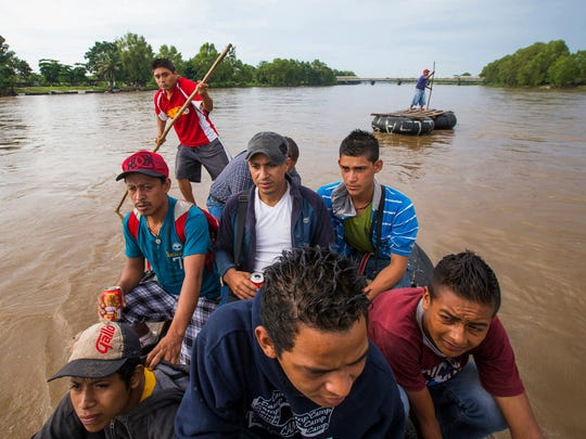 Migrants from Central America illegally cross into Mexico from Guatemala using a raft on the Suchiate River June 22, 2014. They were all headed for the U.S. but weren't sure on the route they were going to take through Mexico. Crime and lack of jobs have sent people from Central America to the U.S. including unaccompanied minors in increasing numbers. Some kids include Jairo Garniga, 16, from Guatemala (front left) and Julio Carcam, 20 from San Salvador (front center) and Antoni Castellan, 17 from Honduras (front right).