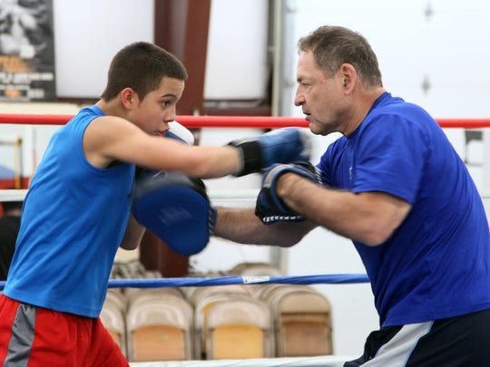 Ivan Calixto, 15 practices boxing techniques with coach Hal Chernoff at Main Street Gym in Salisbury.
