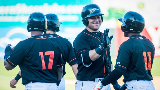 Delmarva Shorebirds center fielder Cedric Mullins (11) is congratualted after a four-run hit following a Charleston RiverDogs error in game one of a double header at Arthur W Perdue Stadium in Salisbury on Monday, May 2.