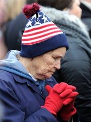 Mergie Allen of Missouri prays in the standing-room-only