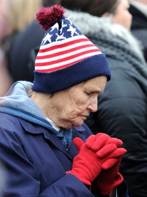 Mergie Allen of Missouri prays in the standing-room-only section outside the Capitol during Donald Trump's inauguration on Friday, Jan. 20, 2017, in Washington, D.C.