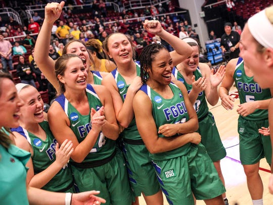 FGCU celebrates after defeating Missouri 80-70 in a