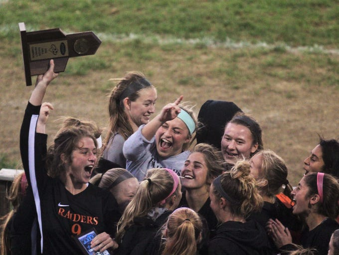 Ryle celebrates its district championship during the
