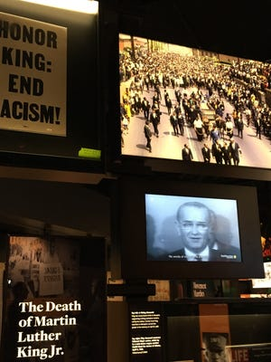 A collection of memorabilia marking the assassination of the Rev. Martin Luther King Jr. in Memphis is one of the nearly 40,000 artifacts in the collection of the National Museum of African American History and Culture in Washington. The placard in the upper left-hand corner was carried by sanitation workers during a memorial march in Memphis on April 8, 1968.