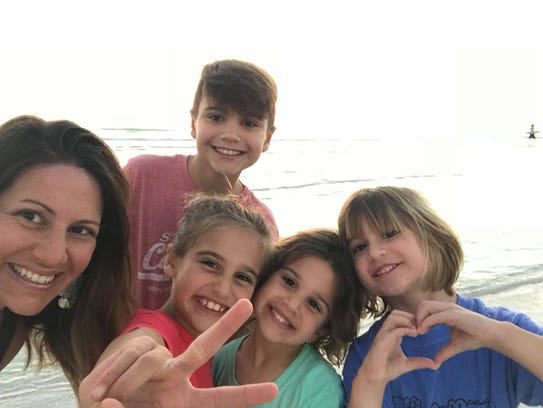 Andrea Remke is joined by her kids at the beach, from