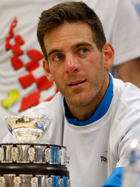 Argentina's Juan Martin Del Potro, holds the trophy after Argentina defeated Croatia in the Davis Cup finals, at the news conference in Zagreb, Croatia, Sunday, Nov. 27, 2016. (AP Photo/Darko Bandic)