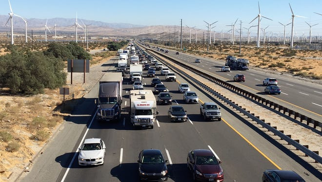 Traffic moves slow on westbound Interstate 10 Sunday as people head home after Thanksgiving. Delays lasted for much of the day.