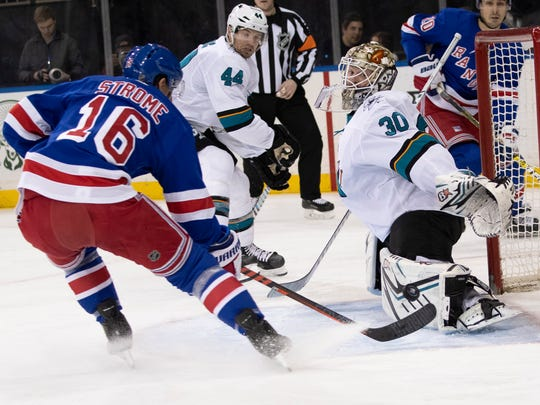 San Jose Sharks goaltender Aaron Dell (30) makes a save against New York Rangers center Ryan Strome (16) during the second period of an NHL hockey game, Saturday, Feb. 22, 2020, at Madison Square Garden in New York. (AP Photo/Mary Altaffer)