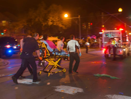 A person is carried on a stretcher as New Orleans police