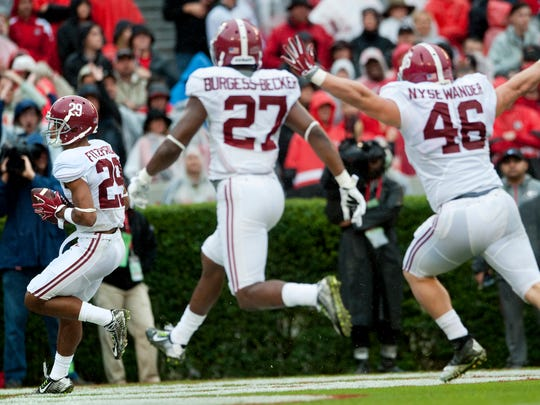 Alabama defensive back Minkah Fitzpatrick (29) carries the ball in for a touchdown after blocking  punt against Georgia at Sanford Stadium in Athens, Ga. on Saturday October 3, 2015.
