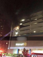 Six to eight cars caught fire in the Walmart parking
