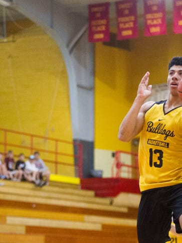 Bettendorf point guard D.J. Carton goes for a layup